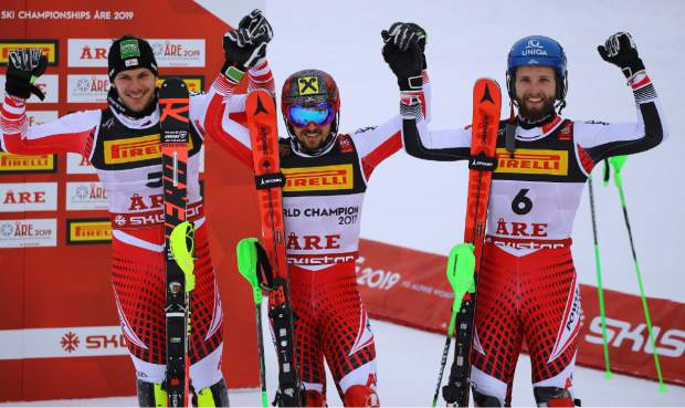 Austria's Marcel Hirscher, center, winner of the men's slalom, celebrates at the finish area with second-placed compatriot Michael Matt, left, and third-placed compatriot Marco Schwarz, at the alpine ski World Championships in Are, Sweden, Sunday, Feb. 17, 2019. (AP Photo/Marco Trovati)