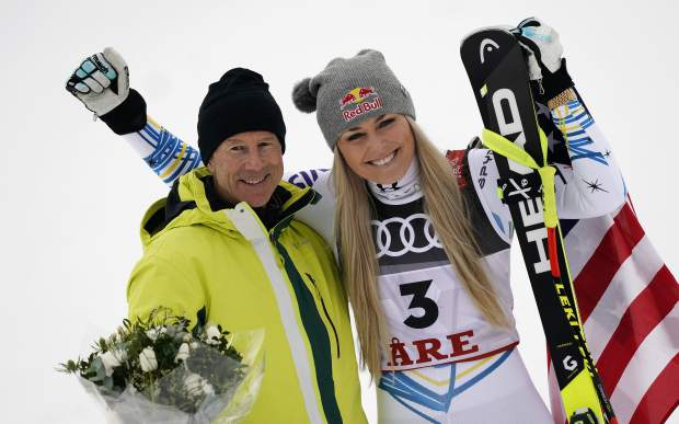 Lindsey Vonn, right, celebrates her third place with Sweden's all-time great Ingemar Stenmark after the women's downhill race, at the alpine ski World Championships in Are, Sweden on Sunday.