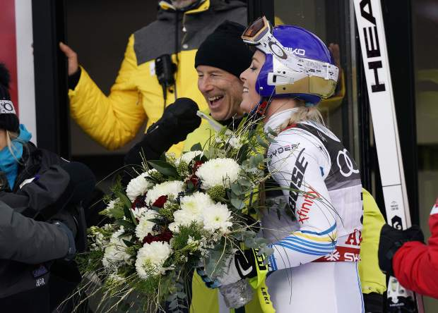 Lindsey Vonn, right, poses with Sweden's all-time great Ingemar Stenmark in the finish area after the women's downhill race at the alpine ski World Championships in Are, Sweden on Sunday.