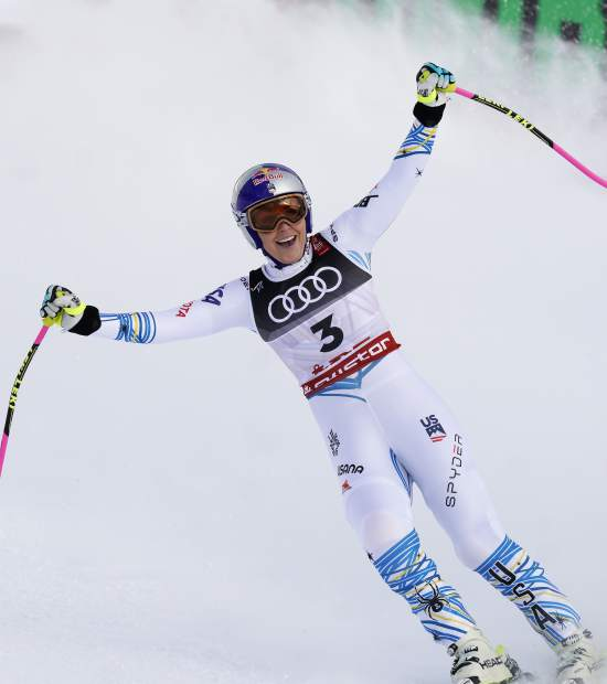 Lindsey Vonn smiles in the finish area after the women's downhill race at the alpine ski World Championships in Are, Sweden on Sunday.