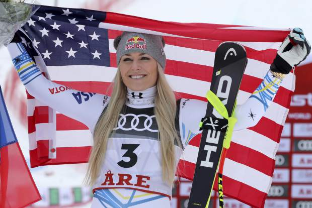 Bronze medalist Lindsey Vonn celebrates after the women's downhill race, at the alpine ski World Championships in Are, Sweden on Sunday.