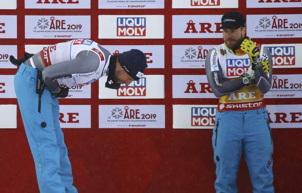 Runner-up Norway's Aksel Lund Svindal, left, bows to the winner Norway's Kjetil Jansrud, after the men's downhill race, at the alpine ski World Championships in Are, Sweden on Saturday