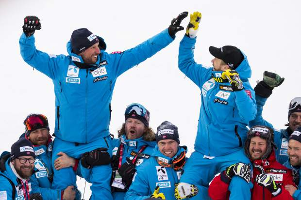 Aksel Lund Svindal of Norway, left, silver medal, and Kjetil Jansrud of Norway, right, gold medal, celebrate after the flower ceremony after the men downhill race at the 2019 FIS Alpine Skiing World Championships in Are, Sweden on Saturday.