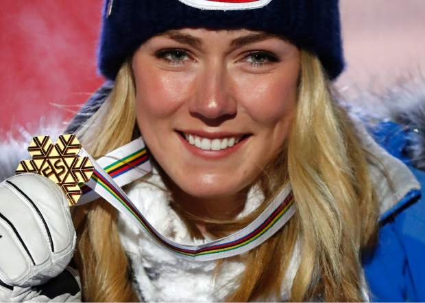 Mikaela Shiffrin poses with her gold medal of the women's super-G, at the alpine ski World Championships in Are, Sweden on Feb. 5.