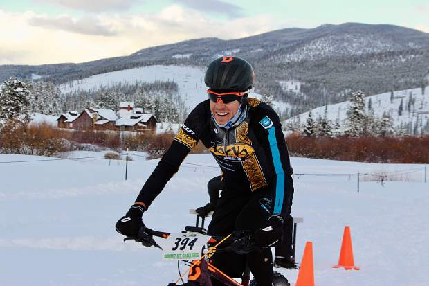 Breckenridge's Taylor Shelden smiles as he approaches the finish line in first place during Saturday's Ullr Bike race at the Gold Run Nordic Center in Breckenridge. Shelden won with a time of 01:03:03.02.