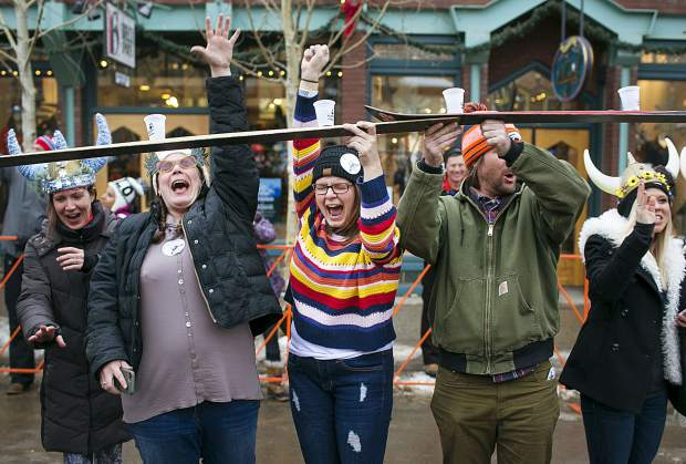 Snow worshippers celebrate after participating in the world's longest ski shot during the 56th Ullr Fest Thursday, Jan. 10, on Main Street in Breckenridge.