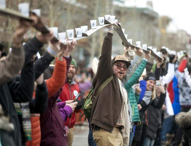 Charles Harris lifts the shot skis during the 56th Ullr Fest Thursday, Jan. 10, on Main Street in Breckenridge.