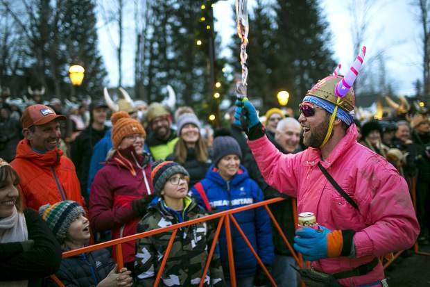 Jake Sklanka celebrate with spectators during the 56th Ullr Fest Parade Thursday, Jan. 10, on Main Street in Breckenridge.