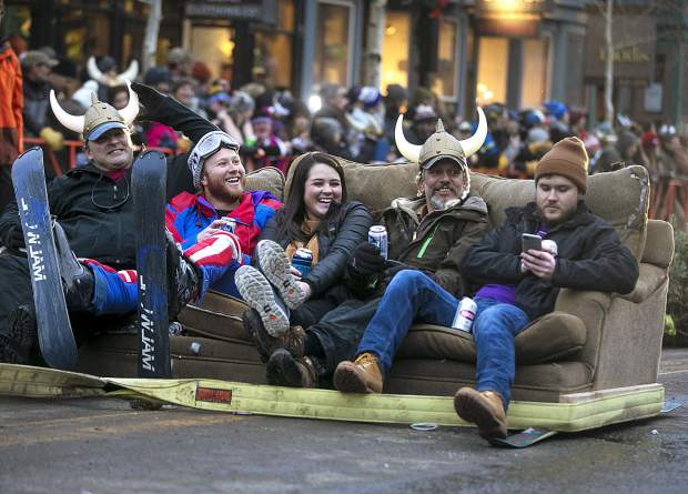 The 56th Ullr Fest Parade participants enjoy the ride on the couch dragged by a vehicle on Main Street Thursday, Jan. 10, in Breckenridge.