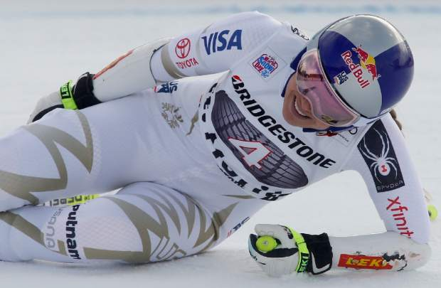 Lindsey Vonn grimaces in pain after getting to the finish area of a women's World Cup super-G ski race in St. Moritz, Switzerland.