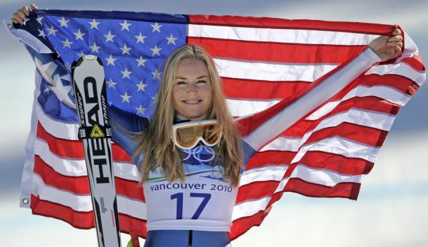 Bronze medalist Lindsey Vonn of the United States hold the Stars and Stripes during the flower ceremony for the Women's super-G at the Vancouver 2010 Olympics in Whistler, British Columbia.