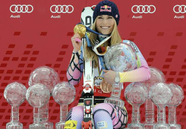 Lindsey Vonn poses in 2010 in Garmisch-Partenkirchen, Germany, with all the Olympic medals and Women's World Cup trophies she had won in her career.