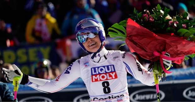 Lindsey Vonn holds a bunch of flowers after completing an alpine ski women's World Cup super-G event in Cortina D'Ampezzo, Italy on Jan. 20.