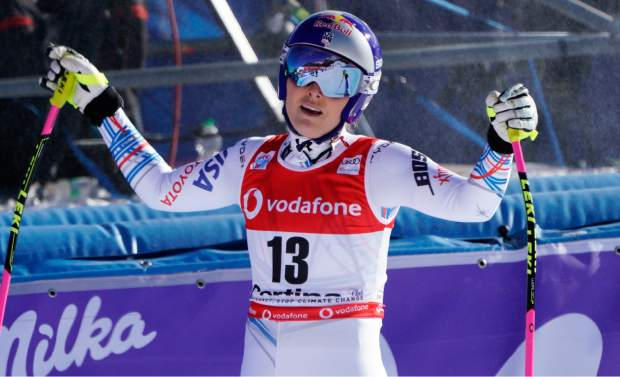 Lindsey Vonn opens her arms after completing in an alpine ski women's World Cup downhill event in Cortina D'Ampezzo, Italy earlier this season.