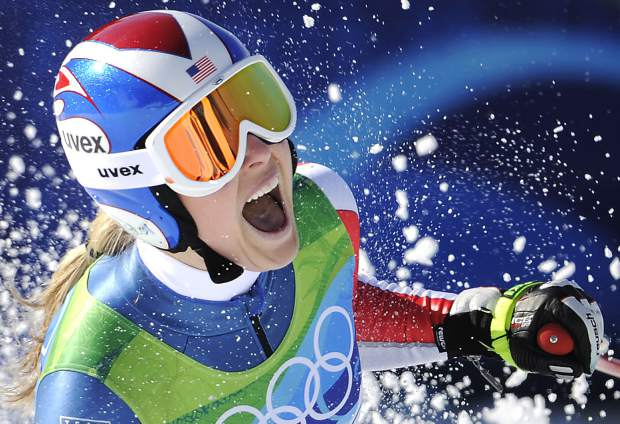 Lindsey Vonn reacts in the finish area after completing the women's downhill race at the Vancouver 2010 Olympics in Whistler, British Columbia. Vonn announced on Friday that she will retire from ski racing after this month's world championships in Sweden.
