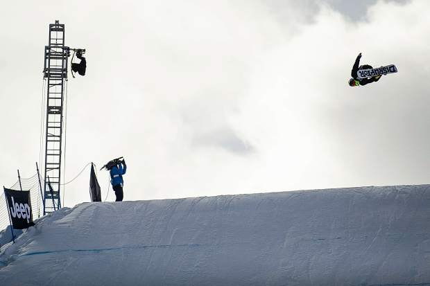 Kyle Mack hits the last jump final run for the men's snowboard slopestyle elimination round for X Games in Aspen on Friday.