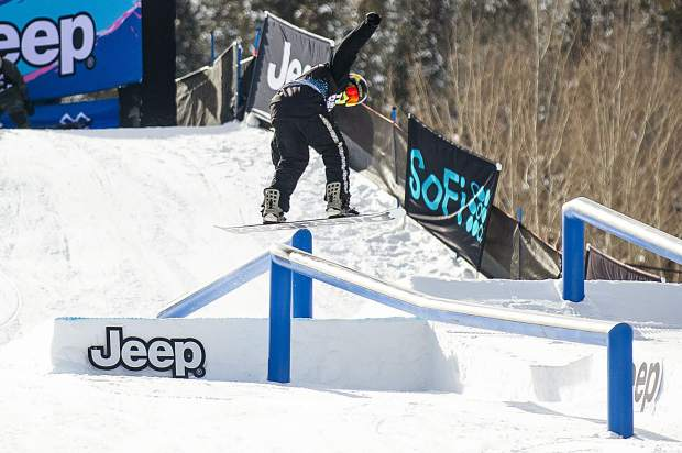 Kyle Mack hits the first rail feature for the men's snowboard slopestyle elimination round for X Games in Aspen on Friday.