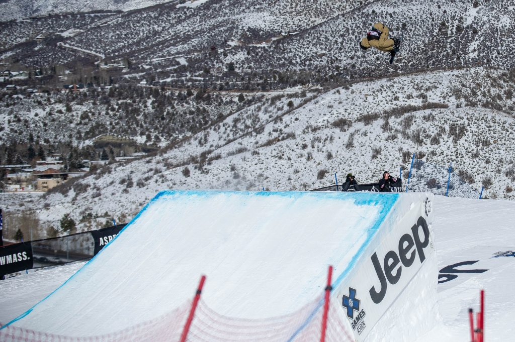 Red Gerard hits the final jump on the slopestyle course on his first run of the men's slopestyle snowboarding final at X Games at Buttermilk Mountain in Aspen.