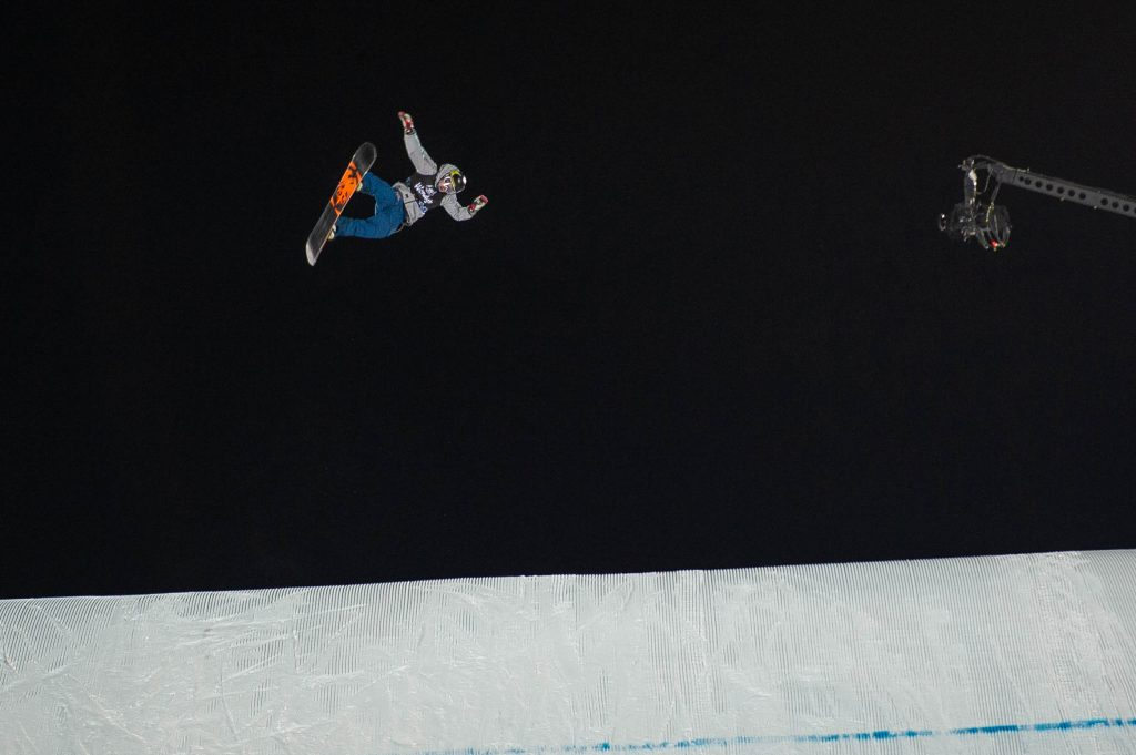 Chris Corning opens up in mid-air high above the big air landing during the men's snownoard big air finals on Friday night at X Game's at Aspen's Buttermilk Mountain.