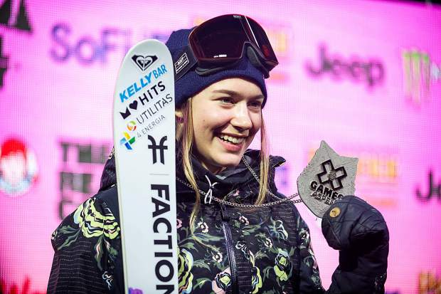 Kelly Sildaru holds up her silver medal from the women's freeski superpipe final at X Games in Aspen on Thursday night.