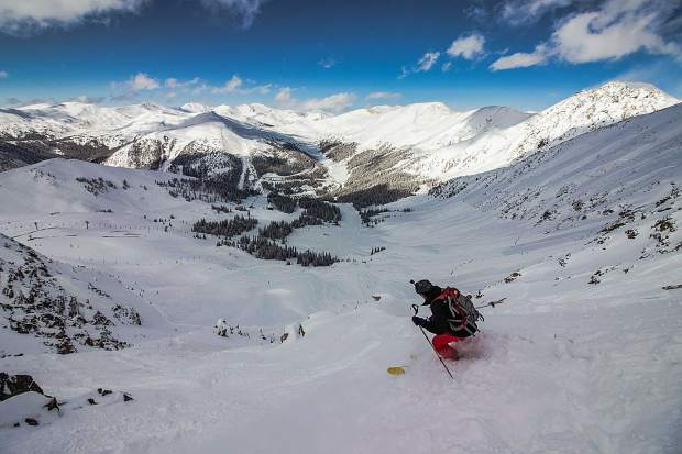 A skier descends a portion of Arapahoe Basin Ski Area's East Wall terrain on Monday, March 4, three days before the ski area closed for two consecutive days due to avalanche concerns specific to two known avalanche paths across US-6 from the ski area: The Widowmaker and the Little Professor.
