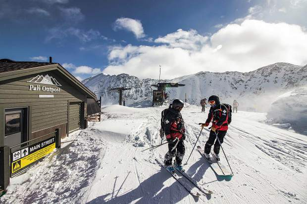 Members of Arapahoe Basin Ski Area's ski patrol chat near the top of the Pallavicini Chairlift on the morning of March 9. These bluebird and deep powder conditions greeted guests to the ski area after A-Basin remained closed the two days prior due to avalanche concerns specific to two known US-6 from the ski area: The Widowmaker and the Little Professor.