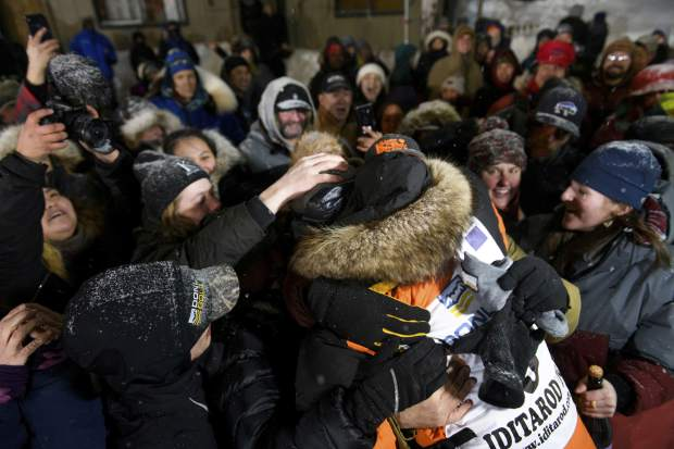 Peter Kaiser is mobbed by friends early on Wednesday in Nome, Alaska, after winning the Iditarod Trail Sled Dog Race. It's the first Iditarod victory for Kaiser in his 10th attempt.