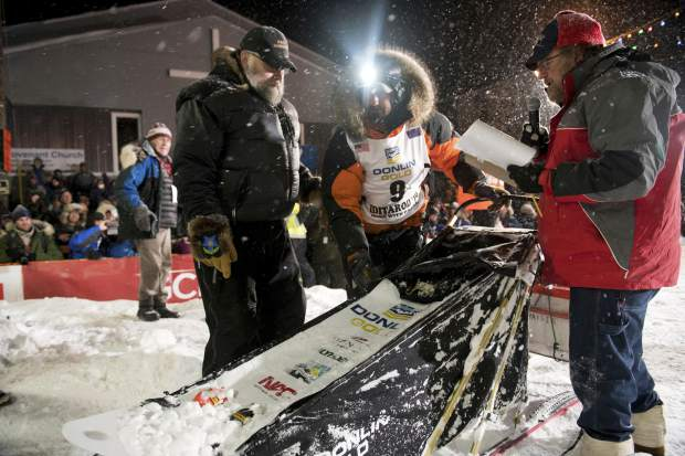 Peter Kaiser (9) checks in at the finish line on Wednesday in Nome, Alaska, after winning the Iditarod Trail Sled Dog Race. It's the first Iditarod victory for Kaiser in his 10th attempt.