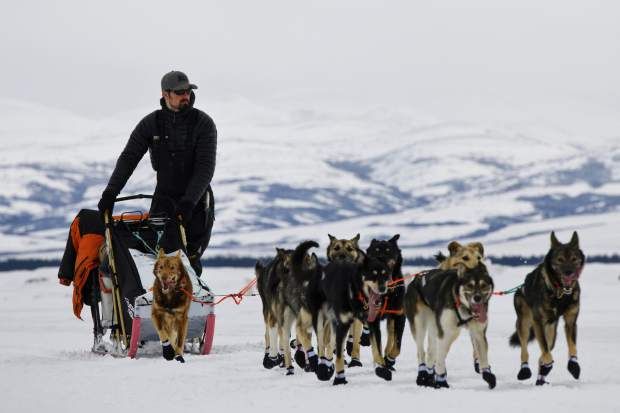 Peter Kaiser arrives at Unalakleet, Alaska on Sunday during the Iditarod Trail Sled Dog Race. Kaiser crossed the finish line early on Wednesday to wn the iconic race.