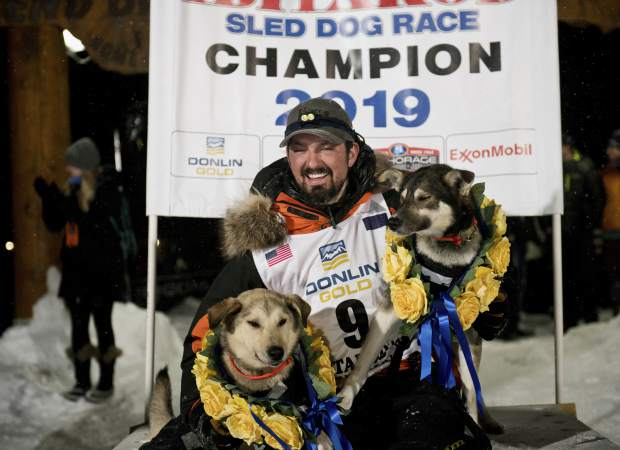 Peter Kaiser (9) poses with his lead dogs, Morrow, left, and Lucy on Wednesday in Nome, Alaska, after winning the Iditarod Trail Sled Dog Race. It's the first Iditarod victory for Kaiser in his 10th attempt.