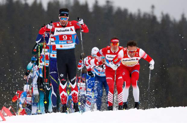 Canada's Alex Harvey, left, competes in a men's cross country 4x10-kilometer relay at the Nordic ski World Championships in Seefeld, Austria on Friday.