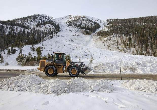 CDOT crews work to remove the snow debris from a controlled avalanche that spilled onto Interstate 70 on March 5 near Loveland Pass.