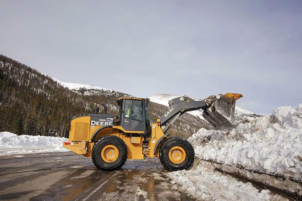 CDOT crew work to remove the snow debris from an controlled avalanche that spilled onto Interstate 70 Tuesday, March 5, near Loveland Pass.