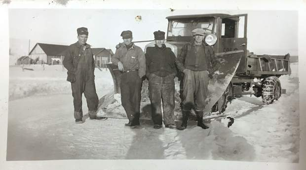 A highway department crew poses for a photo at the Old State Highway 2 between Granby and Kremmling in 1932.