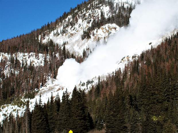 An avalance cascades down toward an avalanche-deflection berm near Mount Bethel just east of the Continental Divide in March 2010.