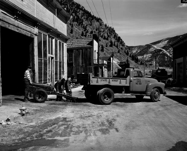 Members of the state highway department set up a 75-millimeter Howitzer for avalanche mitigation work in SilverPlume in March 1953.