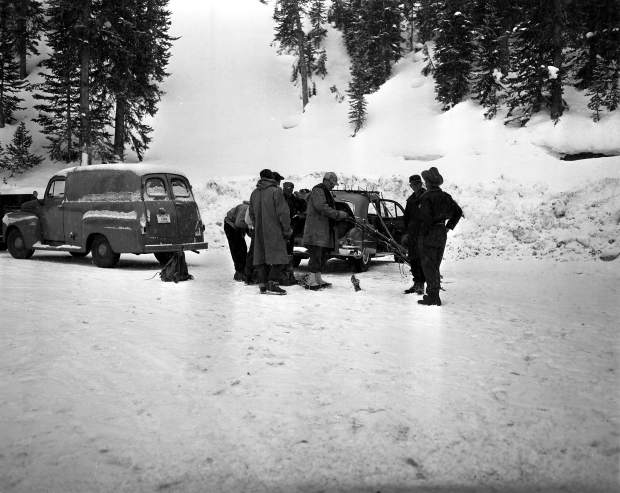 Avalanche mitigation crew members prepare to leave dynamite at the Seven Sisters area of Loveland Pass in January 1953.