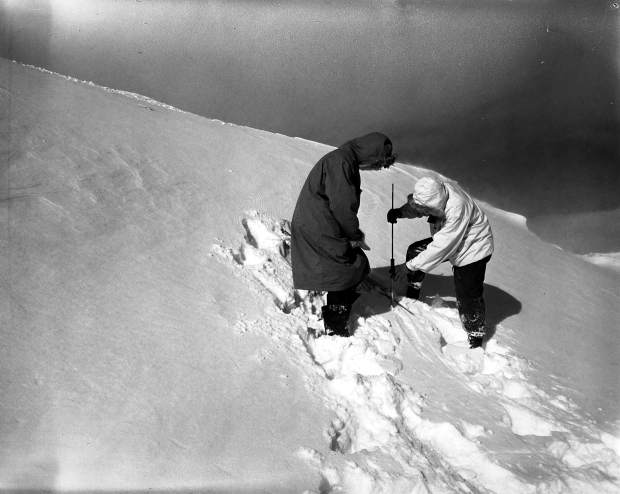 Avalanche mitigation crew members assess the stability of the snowpack on Loveland Pass with a peneprometer in January 1953.