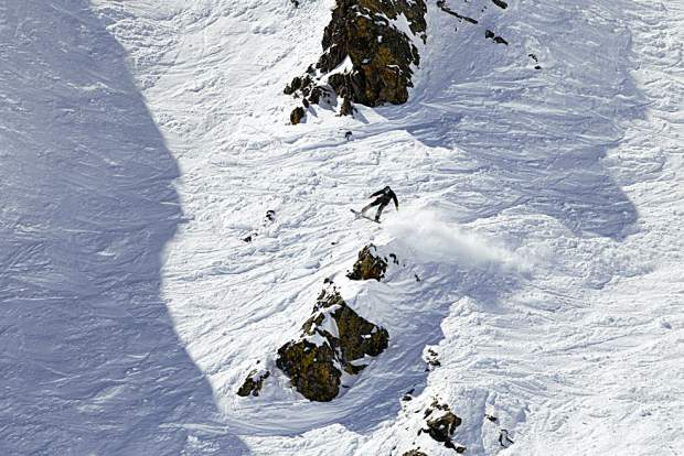 A snowboarder eyes a line within the Six Senses terrain at Breckenridge Ski Resort's Peak 6 during Saturday's Helly Hansen Big Mountain Challenge.