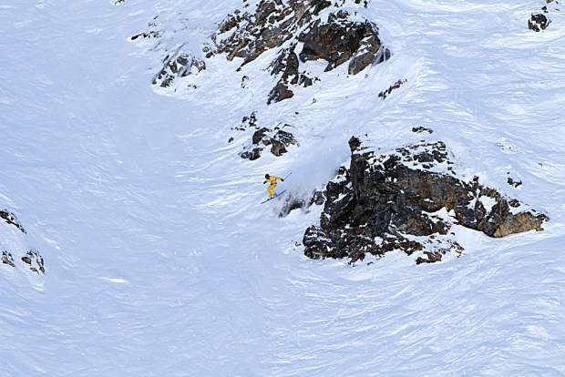 A skier eyes a landing after a natural cliff jump within the Six Senses terrain at Breckenridge Ski Resort's Peak 6 during Saturday's Helly Hansen Big Mountain Challenge.