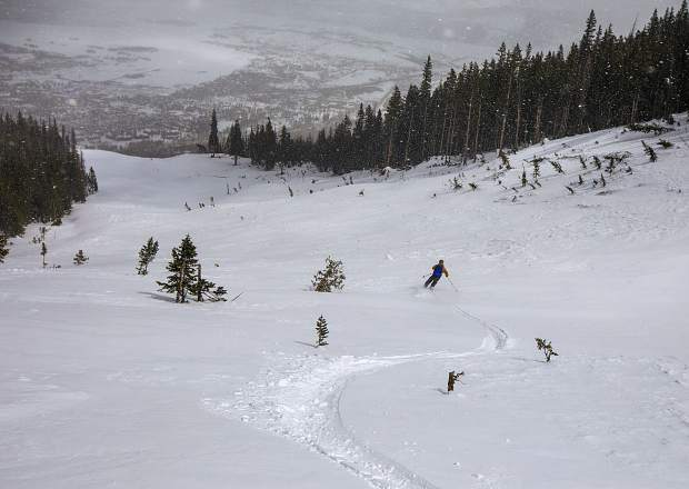 Boulder resident Nick Cote skis on a new avalanche slide path below Peak One of the Tenmile Range Saturday, March 23, near Frisco. Several local skiers, who have already skied the slide path, named it