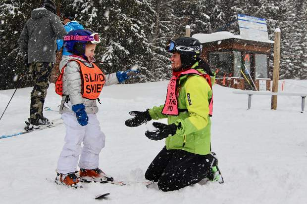 Breckenridge Outdoor Education Center guide Liam Matthews is on the receiving end of a snowball from a youngster named Zoey, 5, during this past weekend's United States Association of Blind Athletes Winter Festival event at Breckenridge Ski Resort, held in conjunction with the Breckenridge Outdoor Education Center.