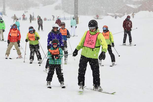 A Breckenridge Outdoor Education Center guide leads blind skiers during this past weekend's United States Association of Blind Athletes Winter Festival event at Breckenridge Ski Resort, held in conjunction with the Breckenridge Outdoor Education Center.
