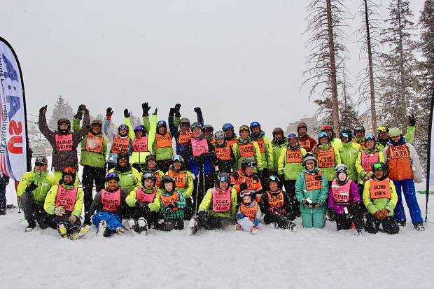 Participants and guides rejoice while posing for a group photo during this past weekend's United States Association of Blind Athletes Winter Festival event at Breckenridge Ski Resort, held in conjunction with the Breckenridge Outdoor Education Center.