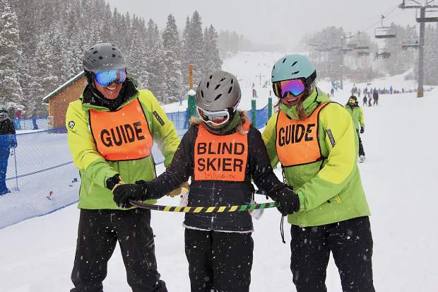 A pair of guides help out a blind skier during this past weekend's United States Association of Blind Athletes Winter Festival event at Breckenridge Ski Resort, held in conjunction with the Breckenridge Outdoor Education Center.