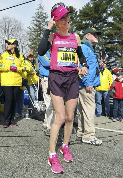 Joan Benoit Samuelson warms up in Hopkinton, Mass., prior to the start of the 117th running of the Boston Marathon in April 2013. The Boston Athletic Association, which organizes the race, said Friday that the two-time champion and Olympic gold medalist will be in the field for the 123rd running of the Boston Marathon on April 15.