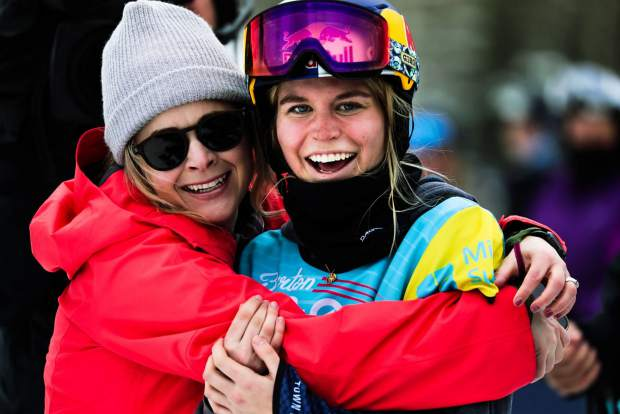 California snowboarder Maddie Mastro, right, celebrates with her friend Anne Jackson, after winning the Burton US Open on Saturday in Vail.
