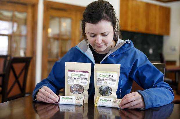 Carly Davis with the CARLbar products, a nutrious on-the-go bars for recovering athletes.