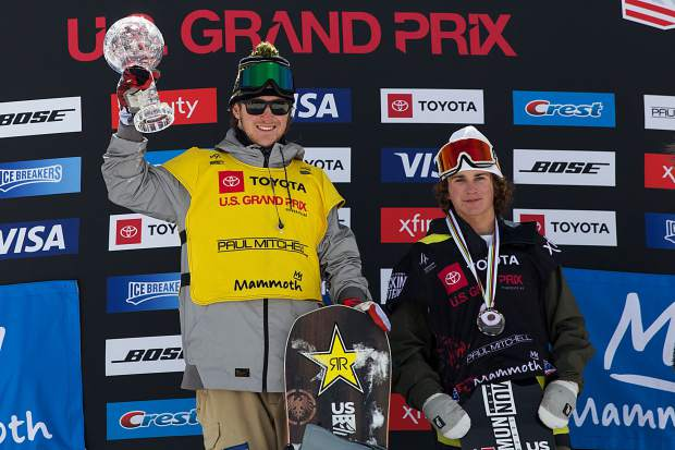 Chris Corning, 19, of Silverthorne (left) hoists the International Ski & Snowboard Federation (FIS) Crystal Globe in the air on Saturday after the 2019 Toyota U.S. Grand Prix slopestyle competition at Mammoth Mountain, California. Corning finished in fifth place at the event, which was strong enough to earn him the FIS slopestyle snowboarding season championship, and the accompanying crystal globe trophy, for the second consecutive year.
