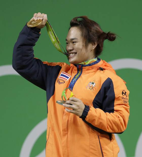 Sukanya Srisurat of Thailand holds her gold medal during the award ceremony for the women's 58kg weightlifting competition at the 2016 Summer Olympics in Rio de Janeiro, Brazil.